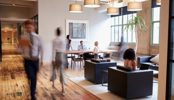 business-people-at-work-in-a-busy-luxury-office-space-picture-id904596282